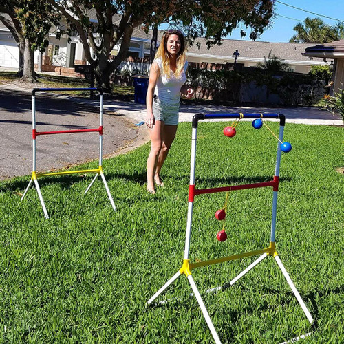 ladder ball game toss with woman